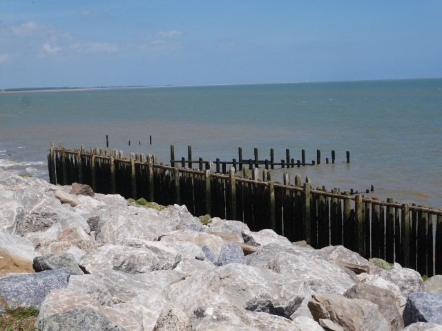 Stone and wooden sea defences at East Lane